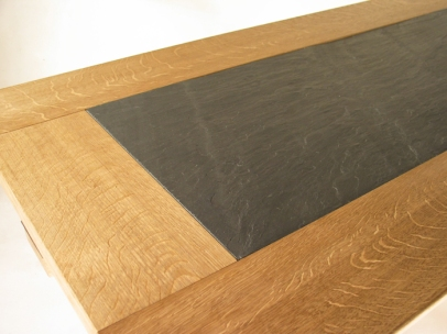 Detail of blue slate and brown oak top
